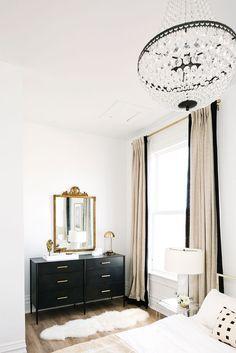 black and white master bedroom decor, glam elegant bedroom design with black dresser, gold mirror, custom drapes, crystal chandelier and fur rug in elegant master bedroom decor Home Design, Decor Interior Design, Design Ideas, Bed Design, Interior Decorating, Design Table, Urban Design, Home Decor Bedroom, Diy Home Decor