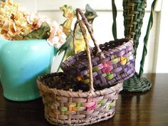 Two lovely, hand painted, German baskets that are such a perfect size. They can be used for Easter baskets and would hold three or four Easter eggs. Also the perfect size for guest soaps, potpourri or small treasures. They are in wonderful shape and beautifully painted with flowers on all sides. The smaller, purple basket has its original tag that reads, Made in Germany, with some numbers written in pencil on the other side. This basket measures 5.25 x 3.5 and is 5.5 tall. The larger basket…
