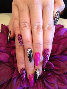 Pink and black gelish gel polish with freehand nail art and Swarovski crystals over acrylic stiletto nails