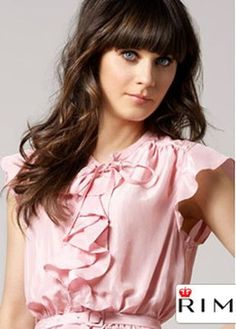 Zoey Deschanel looking soft and romantic.