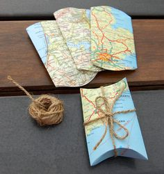 I like this idea. You can use the CTMH Art Philosophy Cricut cartridge to cut the map in the perfect pillow box shape and make it so easy!