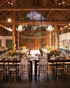 Romantic lighting and long, elegant tables add sophistication to this rustic venue