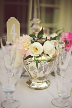 White roses in a mercury-glass vase | Photo by Arina B. Photography