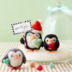 So long, frozen tundra -- these adorable felted penguins are taking up residence at your place. Arrange them in a mantel or tabletop vignette, or finish each penguin ornament with a ribbon loop to hang on your Christmas tree./