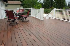 Horizon composite decking in rosewood, railing in white Horizon Plus
