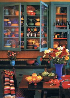 Colorful Bauer and Catalina Pottery Dinnerware Display. I love all the colors and how the pottery comes alive.