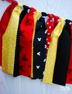Fun red, yellow, black and Mickey fabric tie garland. The perfect touch for your MIckey Mouse Party. Just add my bunting to your party, and make your decorating really easy. Coordinates with any other