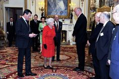 Queen Elizabeth II, accompanied by the Duke of Edinburgh, is greeted by Lord Chancellor an...