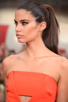 Who: Sara Sampaio What: Clean Lines How-To: Channel the model's simple but standout beauty look for the Mission Impossible: Rogue Nation premiere next time you're running late and have no idea what to do with your hair or makeup. Mist a brush in hairspray and brush your hair into a tight, high ponytail, sculpt with warm bronzer and wing out black liner, lifting high at the outer corners for a wide-eyed effect