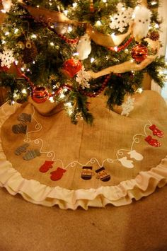 Mitten appliqued christmas tree skirt. $85.00, via Etsy.