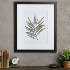 Create a lovely focal point in the living room or guest room with this framed giclee print, showcasing a fern motif.