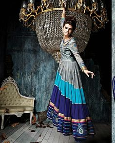 Grey and blue floor length anarkali suit   1. Grey and blue art silk and georgette anarkali suit2. Floral embroidered yoke and sleeves3. Grey and blue flare 4. Comes with matching bottom and dupatta 5. Can be stitched upto size 42 inches