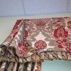 So many details went into fabricating this valance. Skirted corner, decorative trim and a pleated underlay.. Just Lovely...