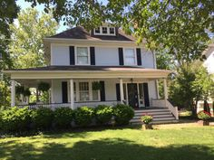 """The front steps and porch of this Kirkwood home seem to say """"Stop by for a visit."""""""