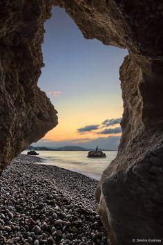 Sunrise view thru de rocks in Rhodes Island, Dodekanisa_ Greece