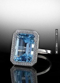Emerald cut aqua marine center stone surrounded by diamond pave. By Bez Ambar. Available at Alson Jewelers. | VIA #WEDDINGPINS.NET