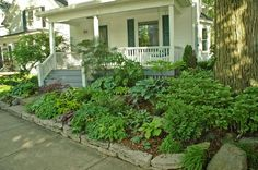 Landscaping Ideas for Slopes | Three views (below) of a Milwaukee lot whose steep slope has been ...