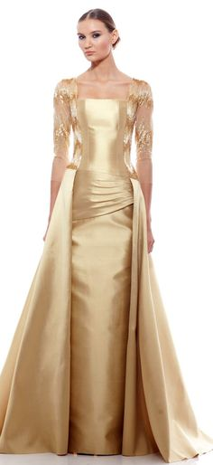 George Chakra haute couture gown in shimmering champagne satin with sparkling, beaded sheer sleves
