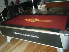 After-a 20 year old pool table. Rehab, recovered, pool table, Harley Davidson, metallic paint, studs, stenciling, painting, furniture, furniture makeover.