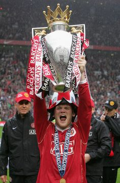 Wayne Rooney's first Premier League trophy came in Here, the striker celebrates with his man utd teammates on the Old Trafford turf. Man Utd Squad, Pier Paolo Pasolini, Manchester United Players, Football Images, Football Icon, Premier League Champions, Wayne Rooney, English Premier League