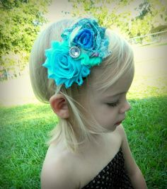 Turquoise/Teal shabby flower headband with crystal embelishment in the center. Great price and low shipping!