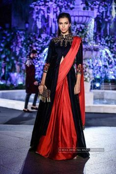 Model walks the ramp for Manish Malhotra on Day 2 of the Lakme Fashion Week Winter/Festive 2016 held in Mumbai - Indo Western glam. Saree Draping Styles, Saree Styles, Indian Attire, Indian Outfits, Indian Wear, Style Fête, Anarkali, Lehenga Choli, Lehenga Suit