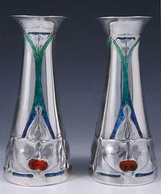 Manufacturer Liberty & Co. Designer Archibald Knox Description Pair of…