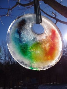 Easy to make and beautiful to look at these Ice Sun Catchers are a great cabin fever buster. With only a few simple supplies children and adults will enjoy creating this fun winter craft project. Great for the whole family.
