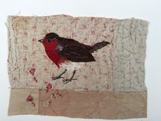 I treasure the old and worn and refashion them into little textile collages in my attic studio in a converted manse in Northumberland, England. Everything I make is individual and unique. This little robin is hand appliquéd and embroidered on to a support of an old quilt fragment. Another old piece of patchwork has been attached to this at the bottom.  The collage is then sewn on to a piece of mount board to make it ready for framing or you could just prop it up on a shelf. There are signs…