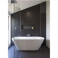 Bathroom with free standing bath #bathrooms #bathroomtiles #baths @graya_construction