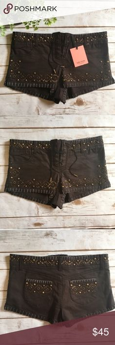 Kate Moss TopShop Lace Up Shorts Kate Moss TopShop brown, Embellished shorts. New with tags! All gems and beads intact. Interior tag shows size 6, 98% cotton, 2% elastane. Extra thread and beads attached.  Measurements approximately  🎀Waist 31 inches  🎀Inseam 1 1/2 inches Topshop Shorts