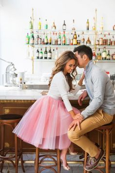 Proof that you don't need extravagance to have a beautiful engagement shoot, the addition of a pink tulle skirt will make your Valentine's Day-themed photos pop.