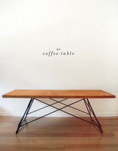 This gorgeous DIY coffee table is made from an upcycled metal base and repurposed wood!