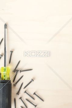 screwdriver and nails - A black screw driver with small nails on a wooden table Photo Class, Wooden Tables, Image Photography, Objects, Nails, Black, Wood Tables, Finger Nails, Ongles