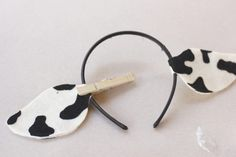 "Whether your child is a cow in the Christmas pageant or is appearing as a cow in a production of ""Charlotte's Web,"" she will need cow ears. These ears are made on a headband base, so they are comfortable and will fit almost anyone. For example, use these ears to dress the baby like a cow if his big brother is going to be a cowboy for..."