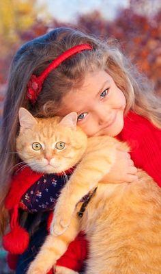 Cute little girl and beautiful cat.