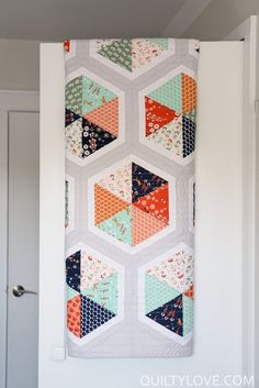 Triangle Hexies Quilt Pattern by Emily of Quilty Love Modern hexagon quilt pattern Plays on the popular triangle and hexagon shapes.    No tricky Y seams or paper piecing!  Easy construction. An 8inch or larger 60degree triangle ruler is recommended but t
