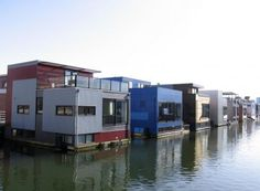 """Amphibious houses are seen in the harbor of the IJburg neighborhood in Amsterdam."" • Margriet Fabar AP"