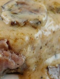 Baked Pork Chop Recipe with a delicious butter garlic sauce and mushrooms! Easy dinner with less than 15 minutes total prep!