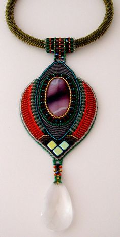 .At first, I thought this was macrame, but I believe it's bead embroidery...... I is beadwork and looks great...