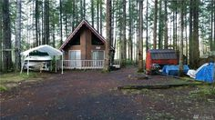 This is a 900 sq. ft. cabin for sale in Hoodsport, Washington with an asking price of $87,500. There is a small storage shed on the property with lots of beautiful trees. Inside, you'll find …