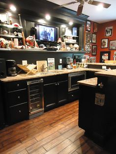 Check out this man cave decked out with sports memorabilia!   #mancave #bar #basement