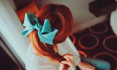 Red hair color and a gorgeous blue bow- reminds me of the cartoon movie 'Anastasia'