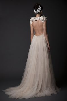 At the young age of 23, Krikor Jabotian set up his own atelier of wedding dresses and formalwear. And with the help of his family, Kriknor reached even greater levels of success. His designs are innovative and futuristic with a subtle nod to classic themes. Each of the wedding dresses and formalwear from his latest collection tell their own unique story of romance and mystery. Scroll along to view the latest collection!