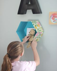 Create a unique gallery wall with a re-purposed hat box shelf.