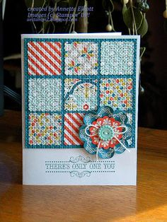 hanmade quilt card ... pretty patterned papers in a nine patch ... embedded embossing ... adorable dimensional flower ... like the blue background showing through as quilt lines ... Stampin' Up!