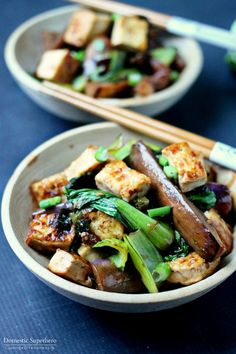 Spicy Asian Eggplant & Tofu Bowls are the perfect healthy dinner! Delicious Japanese Eggplant, Bok Choy, and tofu drenched in a spicy Asian Sauce! Takes less than 30 minutes, too!
