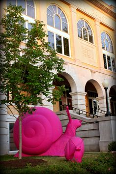 Giant Pink Snails on the square in Bentonville, Arkansas.  These are part of the new 21c Hotel that is currently being built for visitors to the Crystal Bridges Art Museum.