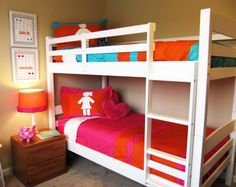 small shared bedroom with bunk bed for boy and girl