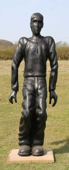 Carved wood Figurative Public Art #sculpture by #sculptor Robert Koenig titled: 'Crouching Man' #art